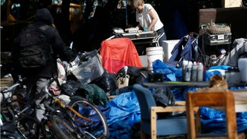 Coronavirus strikes homeless in Los Angeles and Seattle as local officials grapple with outbreak