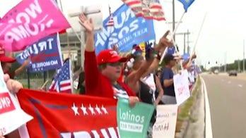 Lawrence Jones talks to Trump supporters outside Joe Biden event in Florida