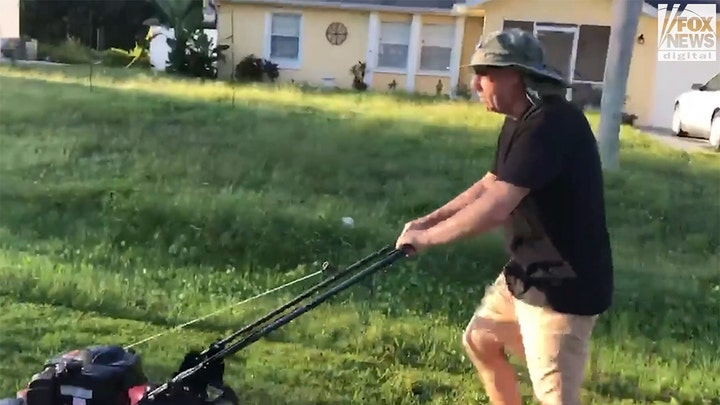 Chris Laundrie mowing the lawn less than 24 hours after coroner determined their son's fiancée was killed by strangulation