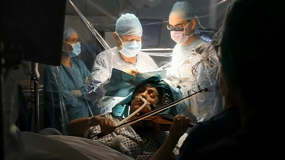 Patient plays violin while surgeons remove brain tumor