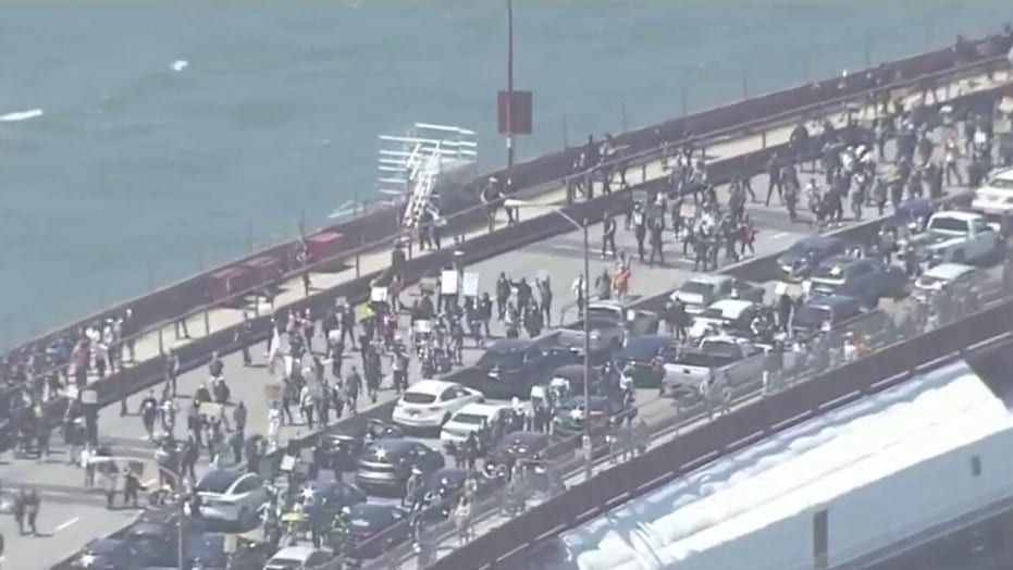 Hundreds march across Golden Gate Bridge in San Francisco protest