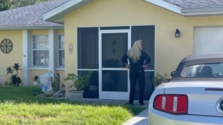 Watch moment Dog the Bounty Hunter knocks on front door of Laundrie Florida home