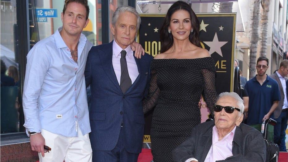 Kirk Douglas' daughter-in-law Catherine Zeta-Jones reacts to his death