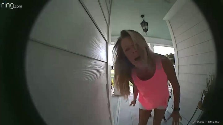 Doorbell video shows neighbors warning couple their porch is on fire