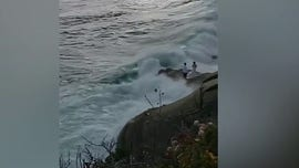 California bride, groom rescued after giant wave sweeps them into ocean during wedding photos