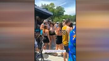 Crowds gather at a bar in Osage Beach, Missouri