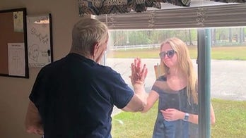 North Carolina woman surprised quarantined grandfather with engagement through window