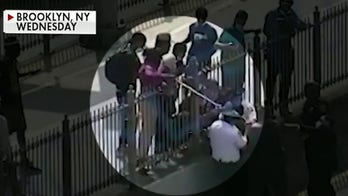 NYPD searching for suspect seen on video hitting officers with broomstick on Brooklyn Bridge