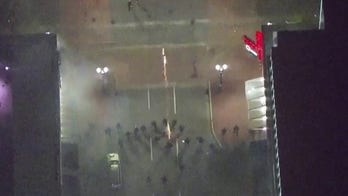 Police shoot tear gas and pepper spray at protesters in Portland, OR