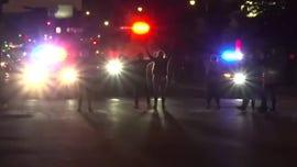 SUV plows through Buffalo police, 2 seriously injured