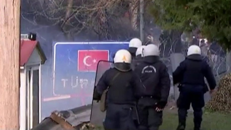 Greece fires tear gas at migrants trying to cross border from Turkey