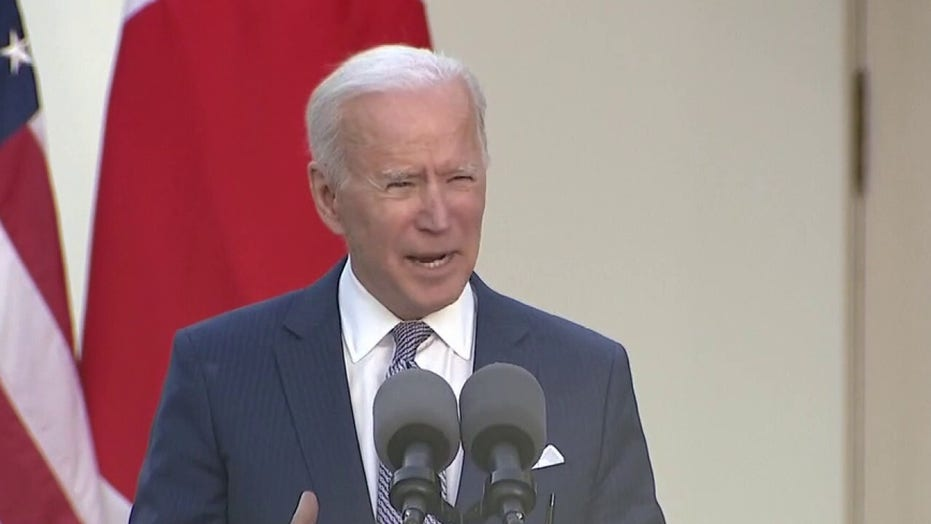 Biden describes border surge as a 'crisis' as he defends refugee moves