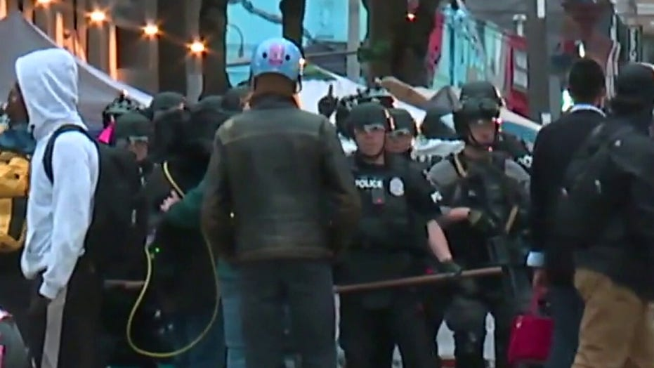 Seattle police clearing out 'CHOP' zone after mayor declares unlawful assembly