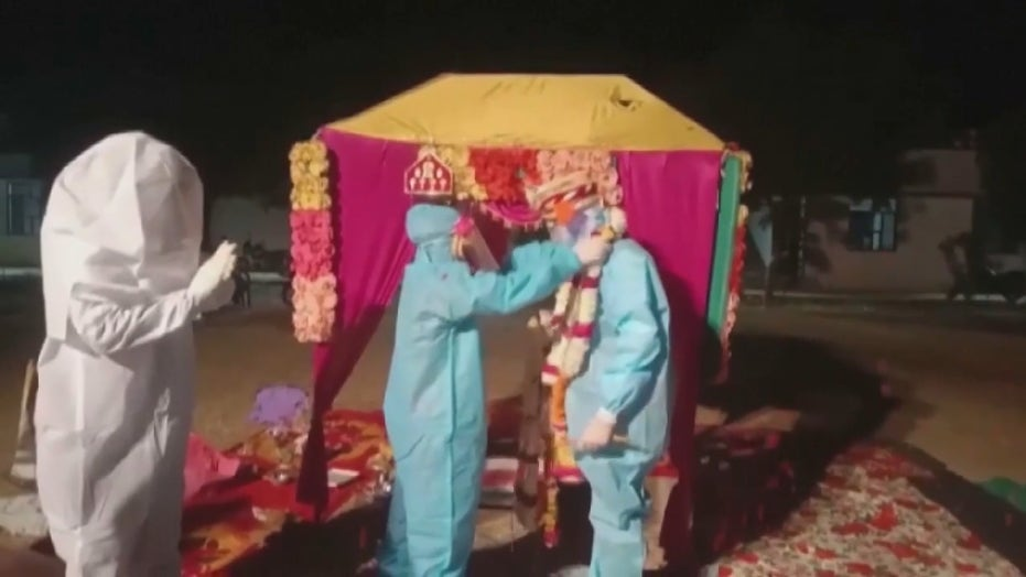 After bride tests positive for coronavirus on wedding day, couple weds in full PPE