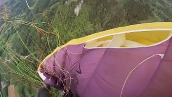 Raw video: Paraglider gets caught in own parachute, tumbles to the ground