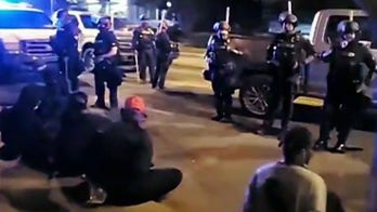 Louisville police declare 'unlawful assembly' after protesters smashed windows