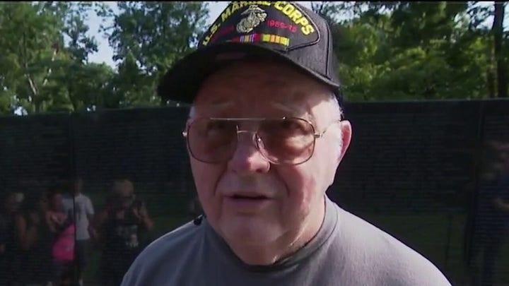 Marine veteran diagnosed with dementia visits Vietnam memorial with family