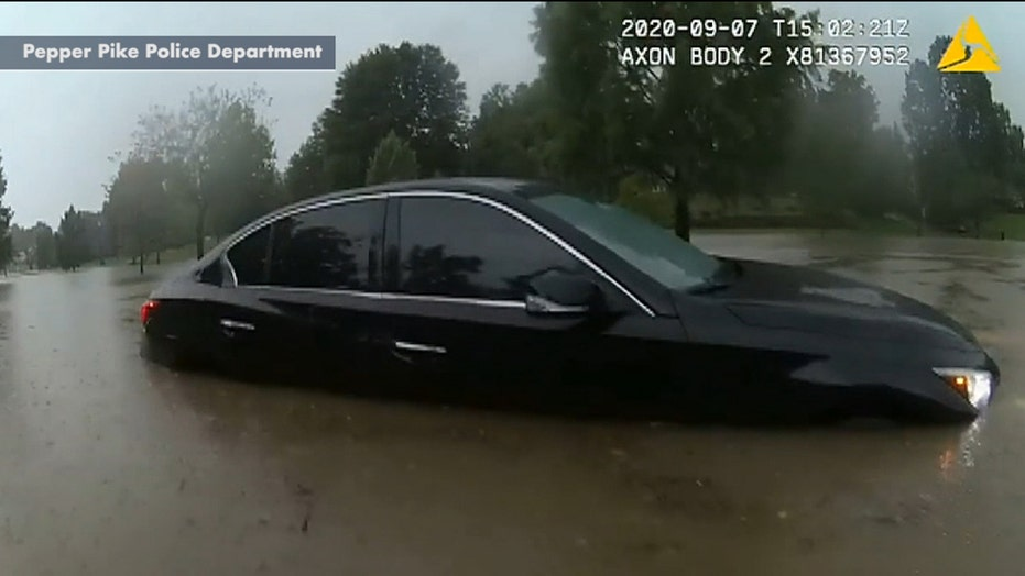 Ohio police officer rescues stranded motorist from flash flooding