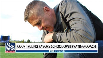 Football coach vows to keep fighting after legal setback over on-field prayer