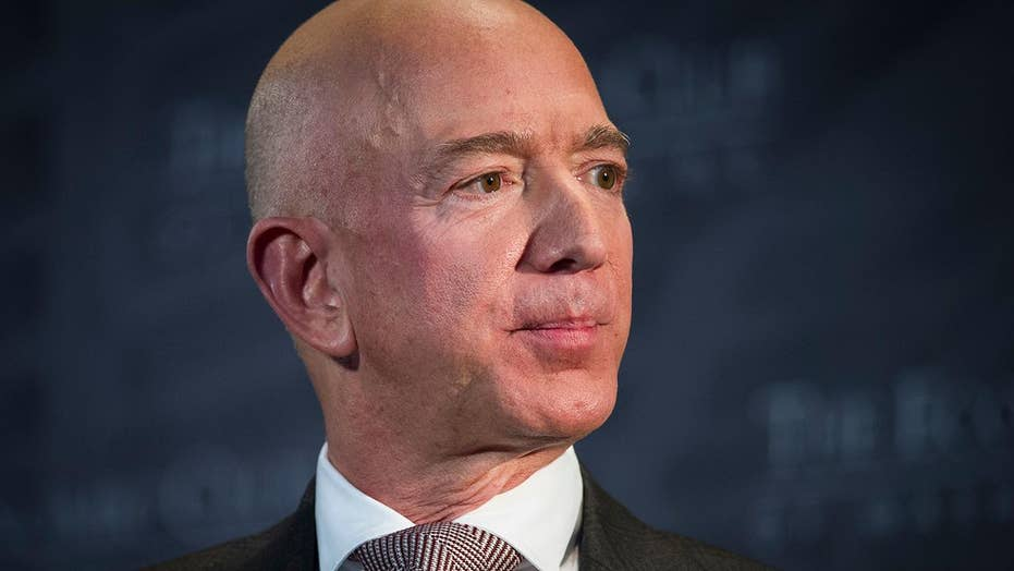 Protesters set up guillotine in front of Jeff Bezos' DC home ...