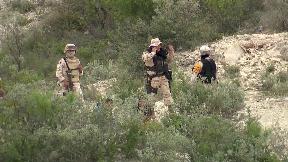 Mexican Marines arrest migrants waiting to cross Rio Grande