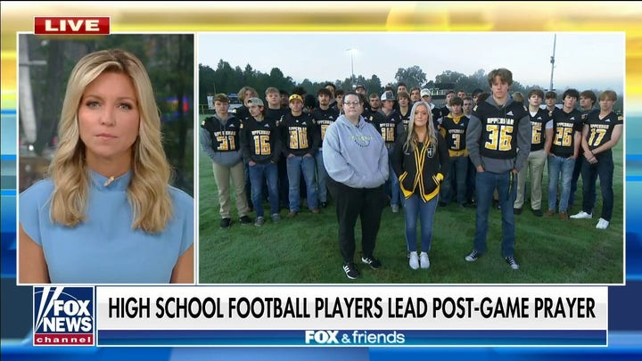 High school football player leads team in prayer after district prohibited coaches