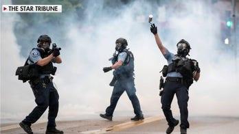 Violence erupts in Minneapolis following black man's death in police custody