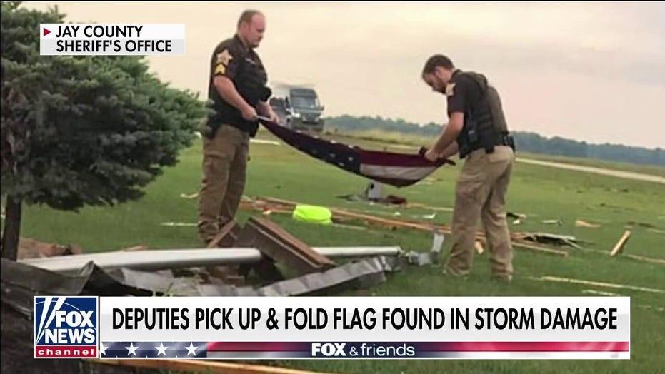 Indiana officers fold American flag found in tornado debris: 'It just felt right'