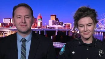 Married off-duty police officers take down restaurant robber on their date night