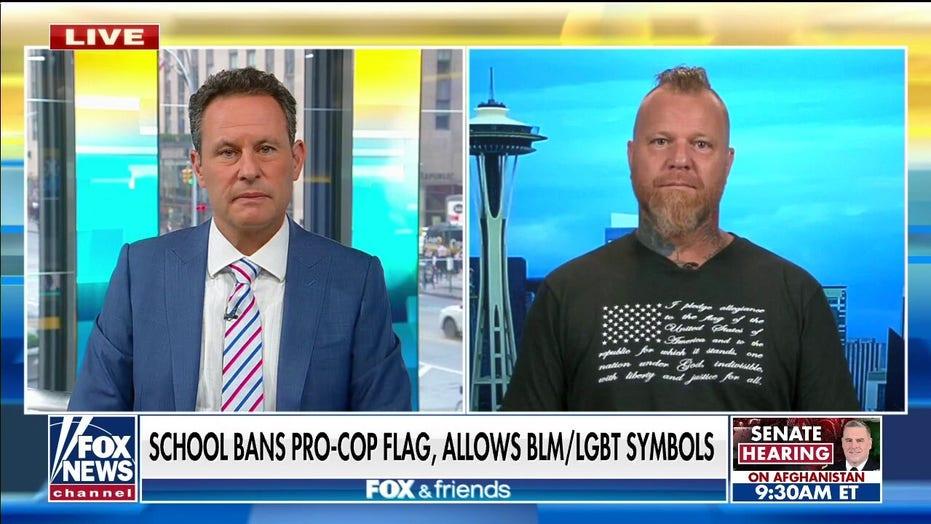 Former officer slams school's 'absurd' ban on sister's pro-police flag in classroom