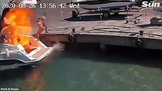 Boat explosion in Italian port sends woman flying through air, video shows