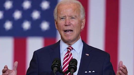 Biden marks grim coronavirus milestone, says 'Trump panicked' on pandemic