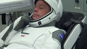 NASA astronauts suit up for history-making mission