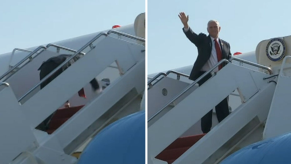 Pence stumbles climbing stairs to Air Force Two