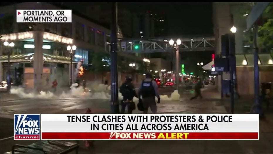 Police clash with protesters in Portland, Oregon