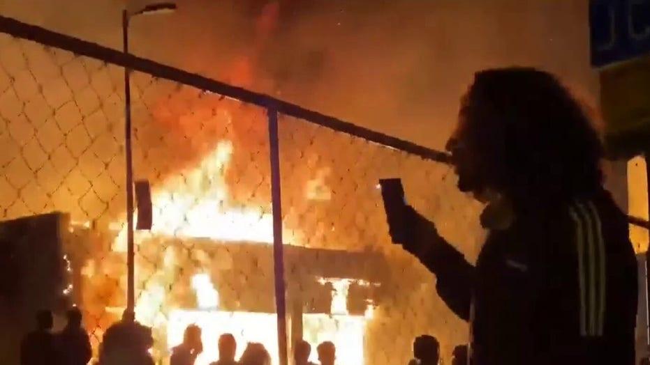 Buildings burn in Minneapolis as rioters ignore curfew order