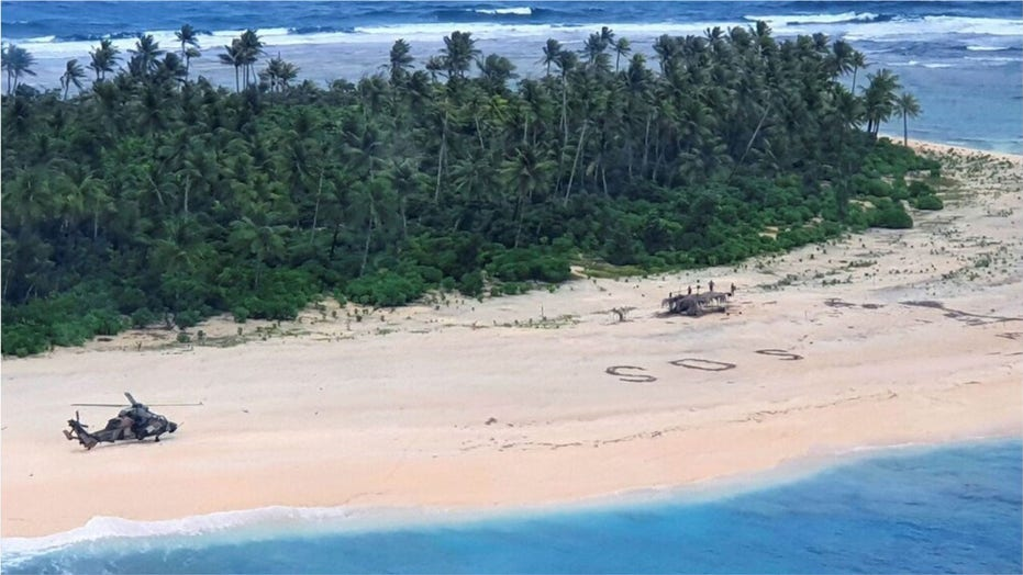 Men rescued from Pacific island after writing SOS sign in the sand