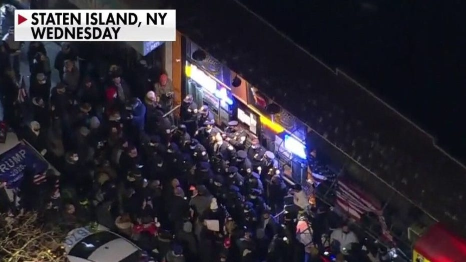 Hundreds of protesters gather outside Staten Island restaurant in show of support for owner