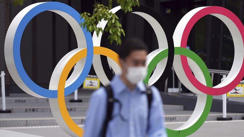 Coronavirus cases surge as Tokyo Olympics begin