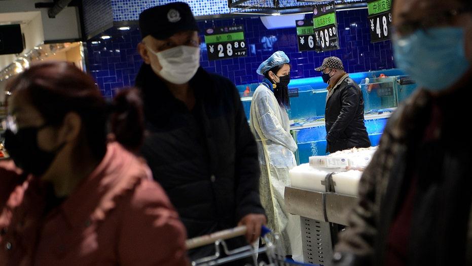 Health experts in China track coronavirus spread