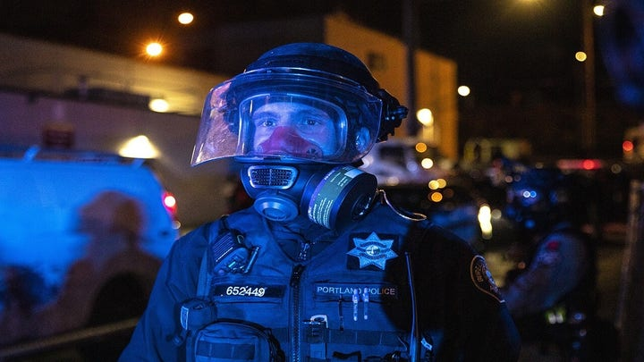 Portland's elite riot control squad resigns after cop charged