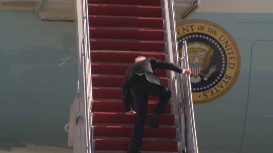 Biden stumbles while walking up steps to Air Force One