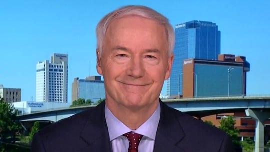 Arkansas Gov. Hutchinson optimistic about economic recovery despite recent high in new COVID cases