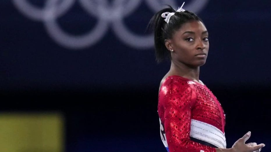Simone Biles rocks tie-dye bikini after winning bronze at Tokyo Olympics