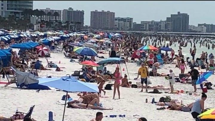 Spring breakers crowd Florida beach despite calls for social distancing