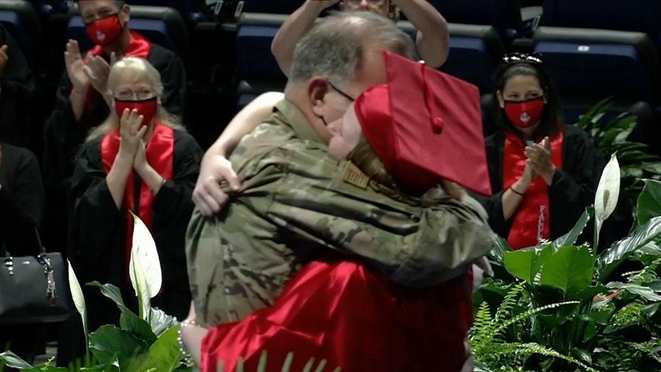 Air Force dad surprises daughter at graduation