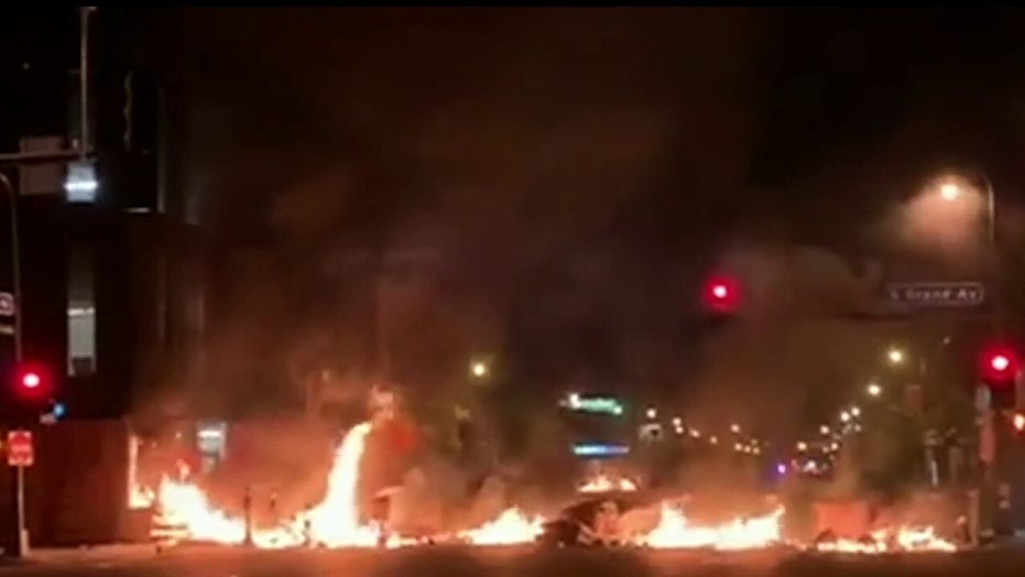 Officials scrambling to quell unrest after night of protests, riots in wake of Floyd death