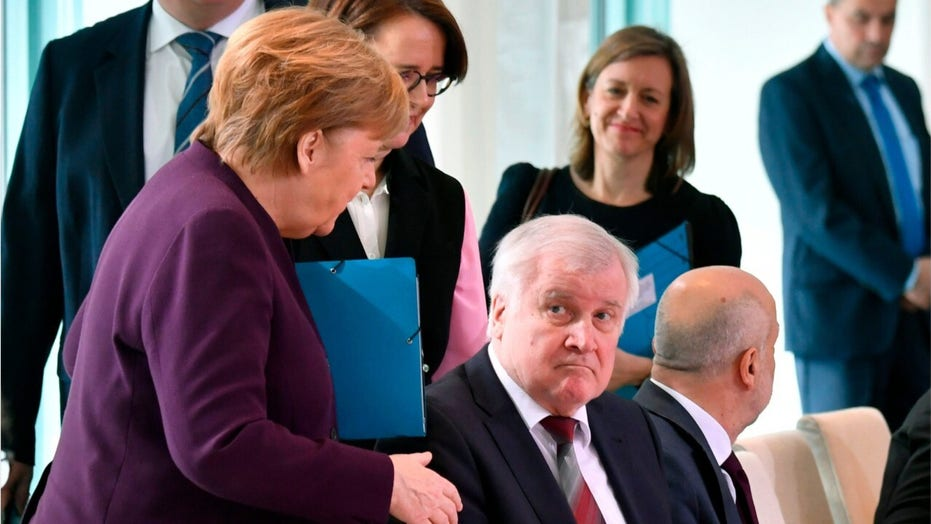 Angela Merkel rebuffed an attempted handshake with Germany interior minister