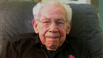 WWII veteran on History Flight identifying remains of two friends lost at war