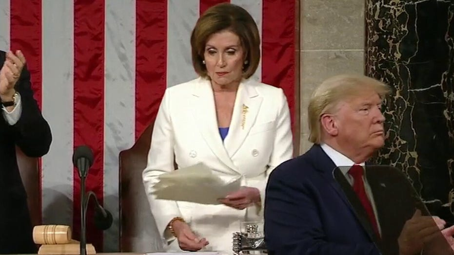 House Speaker Nancy Pelosi rips up her copy of President Trump's State of the Union address